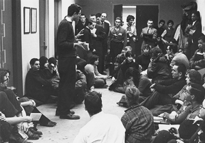 Bernie Sanders (left) standing and addressing a student sit-in against racial segregation on the University of Chicago campus